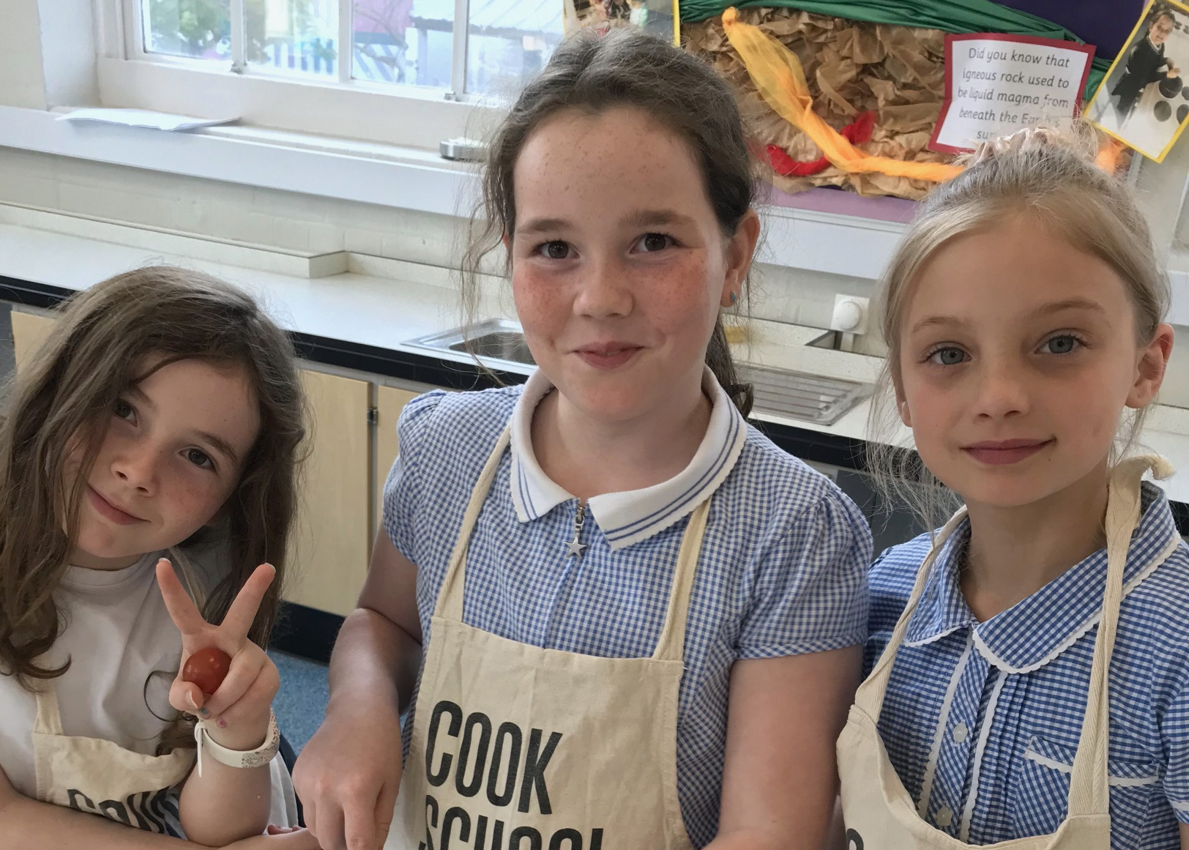 3 girls with aprons cooking